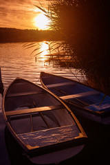 Lonely boats at sunset - relax