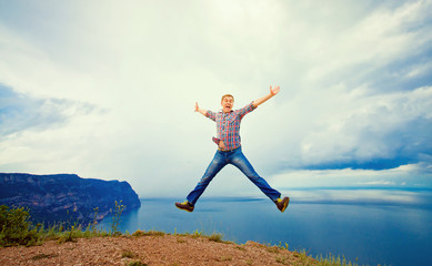 man jumping on the mountain