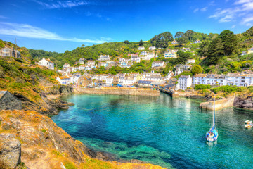 Fototapete - Polperro harbour Cornwall England clear blue and turquoise sea HDR