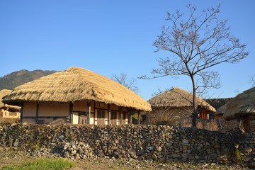 thatched roof house in Korean Traditional old town called NakAn