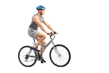 Young male biker riding a bicycle