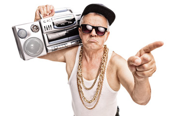 Senior rapper carrying a ghetto blaster on his shoulder