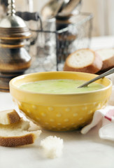 Cream soup with potato and green peas