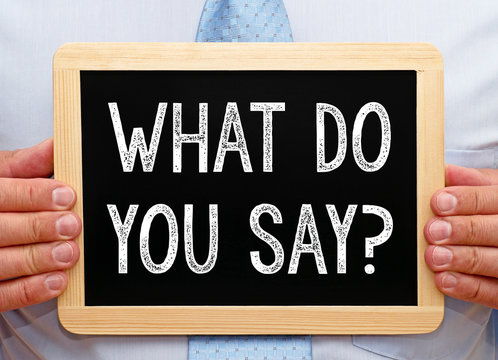 What do you say ? - Businessman with chalkboard