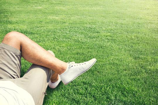 Man resting outdoor on a grass field