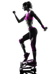 Fototapete - woman fitness stepper weights exercises silhouette