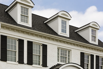White colonial house with windows