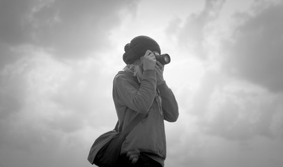 Silhouette of a photographer with cloudy sky
