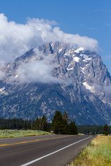 Low-lying clouds over the main road through Grand Teton National Park in Wyoming
