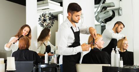 Girl cuts hair at the hair salon