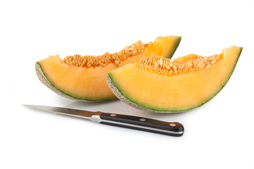 Cantaloupe melon slices with kitchen knife
