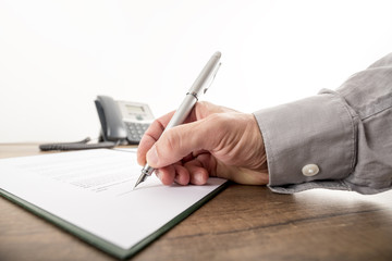 Closeup of businessman or lawyer signing an important contract,
