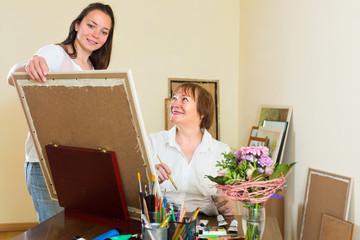 Artist and buyer in the art studio.