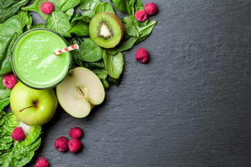 Healthy food green smoothie background top view Wall mural
