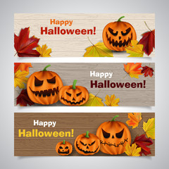 Set of vector Halloween headers with leaves and scary pumpkins on wooden background
