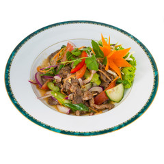 Thai Spicy Beef Salad (Yum Nua) isolated on white