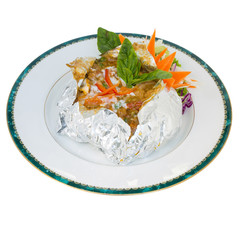 thai steamed fish curry custard in Tin foil (Hormok) isolated on