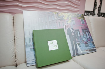 Green and white leather wedding photo book and album with pictur