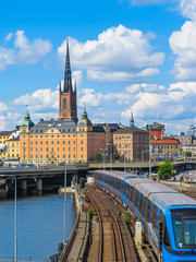 Stockholm, Sweden. View of the Old Town (Gamla Stan) and passing train