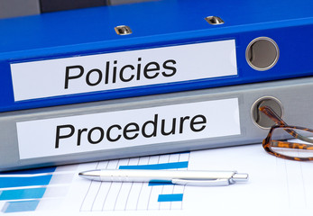 Policies and Procedure - two binders in the office