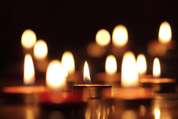 Candles light select focus, black background.