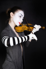 mime playing the violin