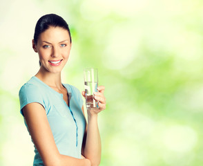 smiling lovely woman with glass of water, outdoor