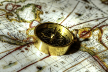 Antique compass on map. Antique brass compass on an old map.