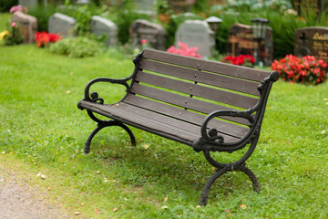 Empty old wooden bench in cemetery