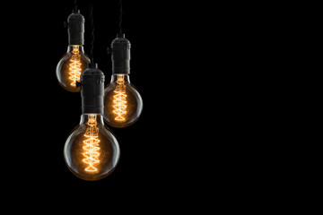 Idea concept - Vintage incandescent bulbs on black background