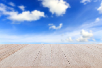 Top wooden table and blur of blue sky background