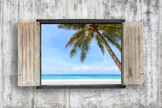 Old wooden windows frame on cement wall and view of sea