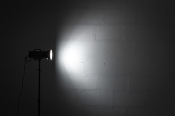 Professional photo studio strobe with reflector.