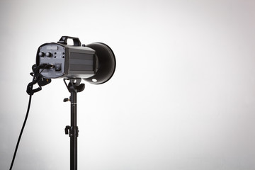 Professional photo studio strobe with reflector.