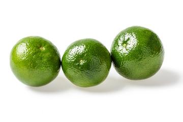 small green limes on white, tilt shift lens