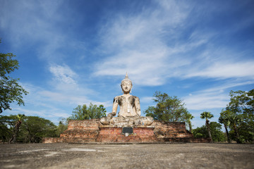 Ancient Buddha statue at Sukhothai historical park, Thailand.
