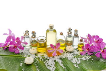 Poster de jardin Spa spa supplies with orchid,oil, candle on banana leaf