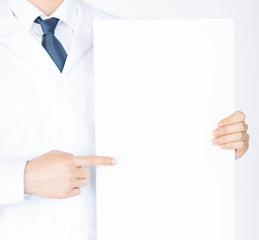 doctor holding blank white banner