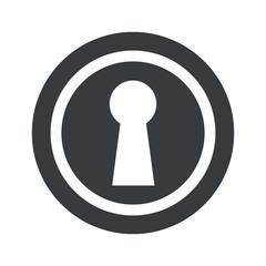 Round black keyhole sign