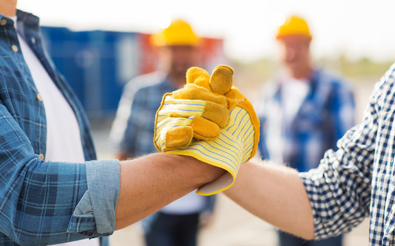 close up of builders hands making handshake