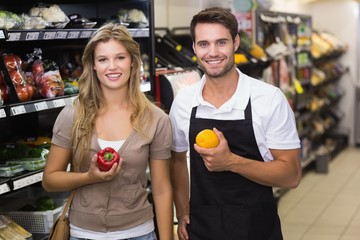 Portrait of smiling blonde woman buying vegetable
