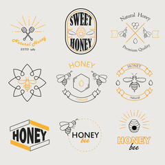 Honey logotypes, badges and labels vector set