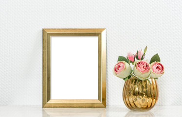 Picture mockup with golden frame and rose flowers. Vintage style