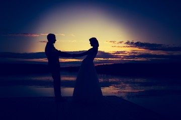 Vintage photo of wedding couple silhouettes in outdoor