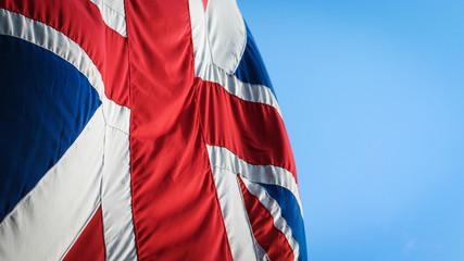 UK flag. The UK Union flag, often referred to as The Union Jack, flying against a blue sky.