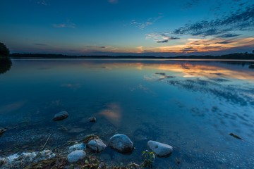 Beautiful lake at sunset landscape with cloudy sky