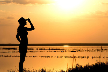 young girl at sunset on the sea