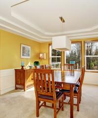 Modernized dinning room with carpet.