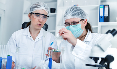 Team of scientists in a laboratory working on chemical testing