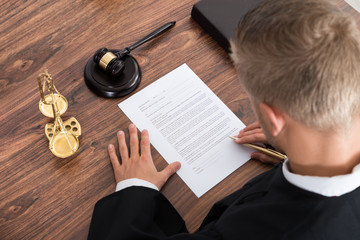 Judge Writing On Paper